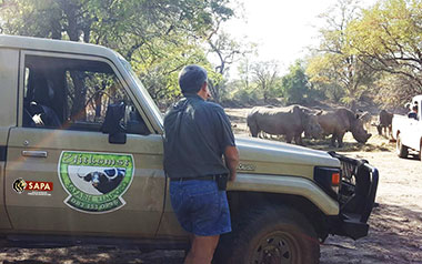 - Ian supervised the feeding process to make sure the Rhinos got fed.  Buffalo and other animals competing for food in the reserve usually chase the rhinos away, adding to their poor condition.